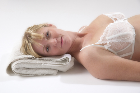 towel head: Woman laying with her head on a folded towel