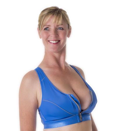busty: Woman wearing a blue sports bra Stock Photo