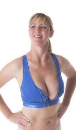 sexy mature women: Woman wearing a blue sports bra Stock Photo