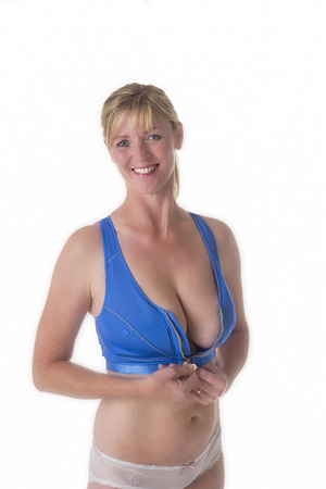 mature sexy woman: Woman wearing a blue sports bra Stock Photo
