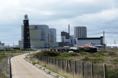 Dungeness Nuclear Power stations A and B with the old lighthouse at Dungeness Kent SE England UK Stock Photo
