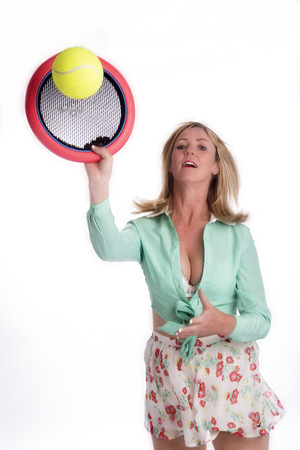 keep fit: Woman playing indoor tennis like game to keep fit Stock Photo