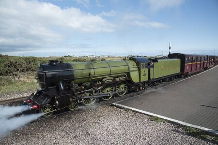 The Green Goddess steam engine at Dungeness Station Kent UK