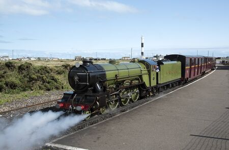 narrow gauge railroad: The Green Goddess steam engine at Dungeness Station Kent UK