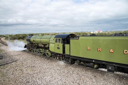 romney: The Green Goddess steam engine at Dungeness Station Kent UK