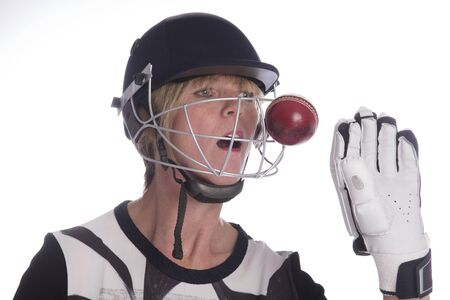 cricketer: Cricketer wearing safety helmet being hit by a cricket ball Stock Photo