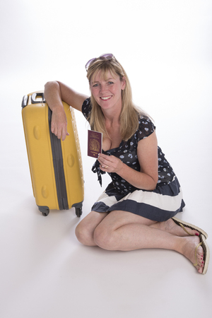 holidaymaker: Woman holidaymaker with suitcase and passport