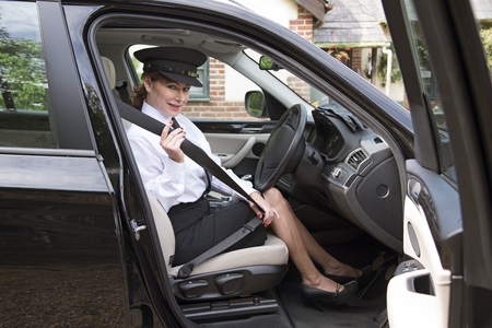 seat belt: Professional woman driver adjusting her seat belt Stock Photo