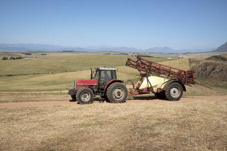 crop sprayer: Farm tractor and crop sprayer in the Swartland region of South Africa