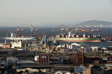 Container carrier ships alongside port of Cape Town South Africa
