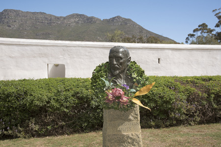 smuts: Sculpture of Jan Christian Smuts decorated with a Protea wreath at Riebeeck West South Africa