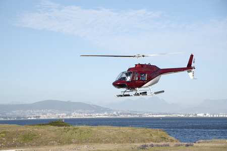 flight mode: Helicopter flight with a backdrop of mountains close to Cape Town South Africa Editorial