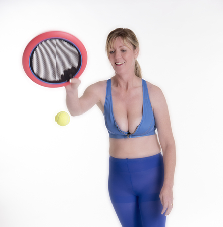 keep fit: Woman playing a ball game to tone her body and keep fit