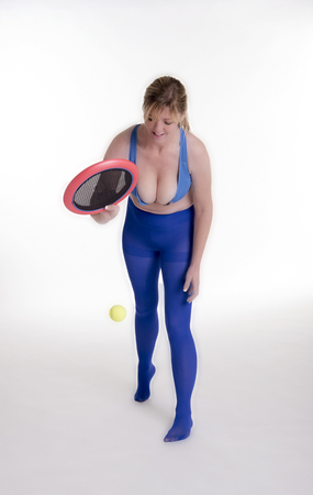 Woman playing a ball game to tone her body and keep fit