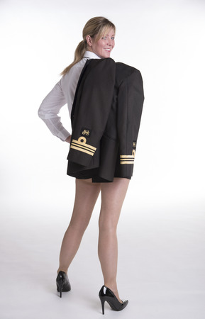 sexy skirt: Female naval officer in uniform wearing a sexy skirt Stock Photo