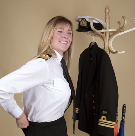 Female naval Lt Commander getting ready for duty Stock Photo