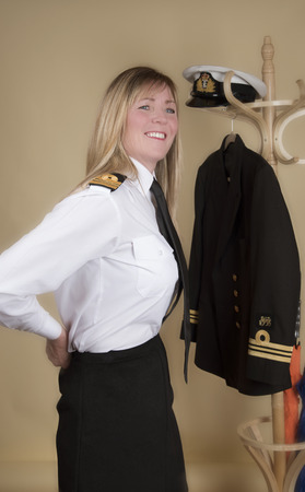 lt: Female naval Lt Commander getting ready for duty Stock Photo