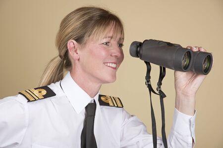 shirtsleeves: Woman Lt Commander holding binoculars