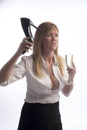 enrage: Woman holding a stiletto shoe in extreme anger
