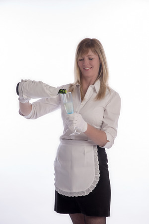 sparkling wine: Waitress serving a glass of sparkling wine