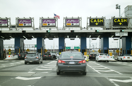Toll Plaza and cars waiting to pass through Robert F Kennedy Bridge New York USA Editorial