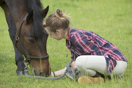 pony girl: Teenage girl with her pony