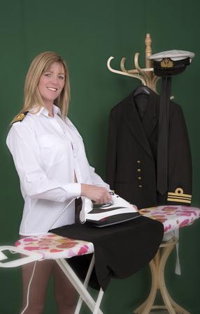uniform skirt: Woman naval officer ironing her uniform skirt