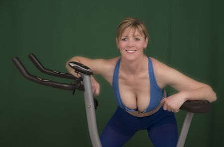 Woman working out before riding an exercise bike