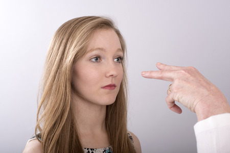 outrage: A two fingure gesture towards a young womans eyes
