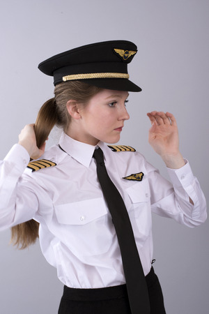 Young female airline pilot in uniform
