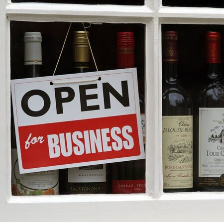 sign in: Hanging Sign in wine shop window Open For Business