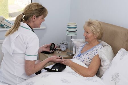 prick: Nurse showing patient how to test blood with a finger prick device