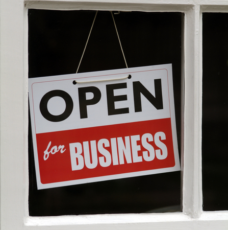 shop window: Hanging Sign in shop window Open For Business