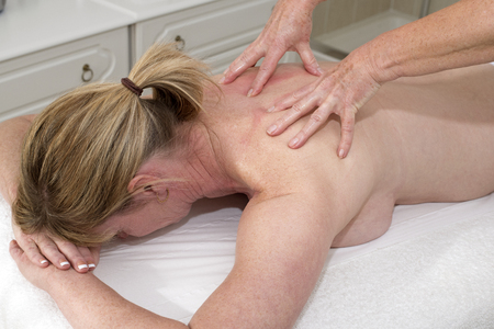 back rub: Masseuse giving a massage to a female client