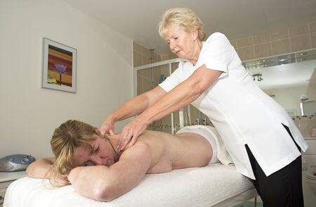 acupressure hands: Masseuse giving a massage to a female client