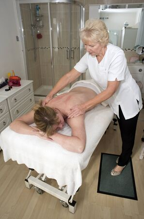 masseuse: Masseuse giving a massage to a female client