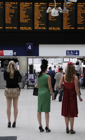concourse: Well dressed women at Waterloo main line station enroute for a day at the races Editorial