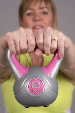 kettle bell: Woman exercising with a kettle bell weight