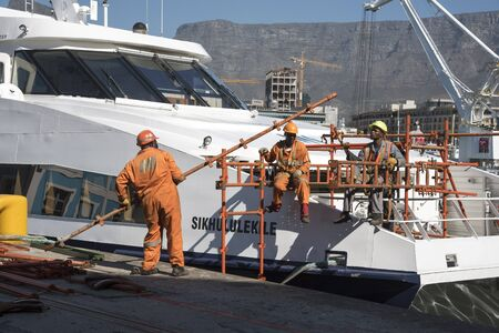 hull: The Sikhululekile a Robben Island passenger ferry seen in Cape Town today undergoing repairs to the hull today. South Africa. April10 2016 Picture; Peter TitmussAlamy Live News