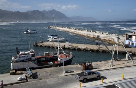 alongside: Fishing boat alongside the New Harbour at Hermanus Western Cape South Africa