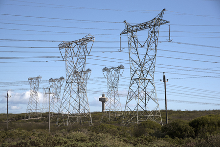 MELKBOSSTRAND NORTH OF CAPE TOWN SOUTH AFRICA - APRIL 2016 - Power lines feed electricity to the national grid from the Koeberg nuclear power station Imagens - 56380202