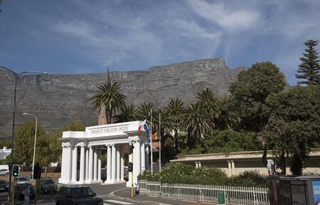 nelson: TABLE MOUNTAIN AND MOUNT NELSON HOTEL CAPE TOWN SOUTH AFRICA - APRIL 2016 - The main entrance to the famous Mount Nelson hotel on Government Aveue in the city center of Cape Town South Africa Editorial