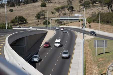 approaches: N2 HIGHWAY CAPE TOWN SOUTH AFRICA - APRIL 2016 - A flyover across the N2 Highway as it approaches Cape Town South Africa Editorial