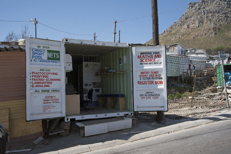 southern africa: IMIZAMO YETHU TOWNSHIP WESTERN CAPE SOUTH AFRICA - APRIL 2016 - A business being run from a metal container in Imizamo Yethu township in Hout Bay Southern Africa