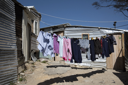 southern africa: IMIZAMO YETHU TOWNSHIP WESTERN CAPE SOUTH AFRICA - APRIL 2016 - Washing hanging out to dry in this crowded township at Hout Bay Southern Africa