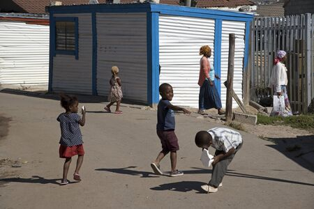 southern africa: IMIZAMO YETHU TOWNSHIP WESTERN CAPE SOUTH AFRICA - APRIL 2016 - Children playing on the street in this township in Hout Bay Southern Africa