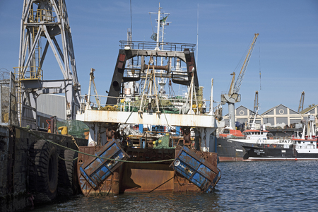 fishing fleet: CAPE TOWN SOUTH AFRICA - APRIL 2016 - Fishing fleet vessels alongside in Cape Town harbor Southern Africa