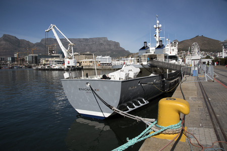enigma: CAPE TOWN SOUTH AFRICA - APRIL 2016 - Luxury expedition yacht Enigma XK a former Scottish fisheries protection vessel alongside in Cape Town harbor Southern Africa