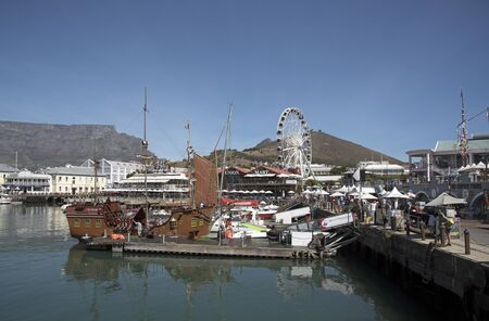 va: CAPE TOWN SOUTH AFRICA - APRIL 2016 - The V&A Waterfront development a working harbor and leisure location for tourists