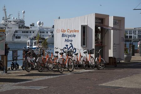 va: CAPE TOWN SOUTH AFRICA - APRIL 2016 - The V&A Waterfronts cycle hire station where tourists may rent a bike to tour the Waterfront area